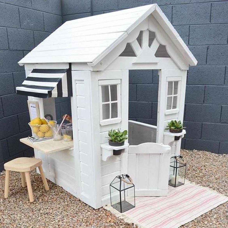 domek w ogrodzie dla dzieci-21
